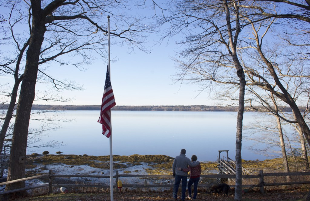 """Mark and Glenda Wyman look out from their property in Brunswick at the subtidal waters of Maquoit Bay, where a proposed oyster farm would be located. """"I don't have any problem with aquaculture,"""" says Mark Wyman, who worries about deer crossings as well as about discord in Mere Point. """"I just don't think this is a good place for it."""""""
