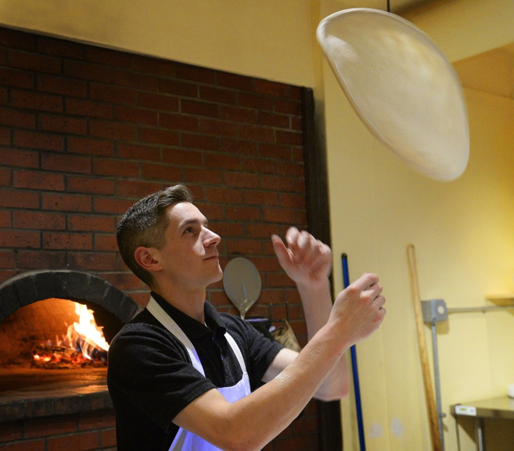 Pizza maker Jay Whitney lets the dough fly at Pizzarino.