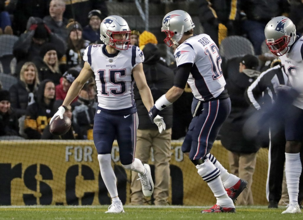 Chris Hogan, left, and Tom Brady connected for New England's only touchdown in a 17-10 loss in Pittsburgh on Sunday.