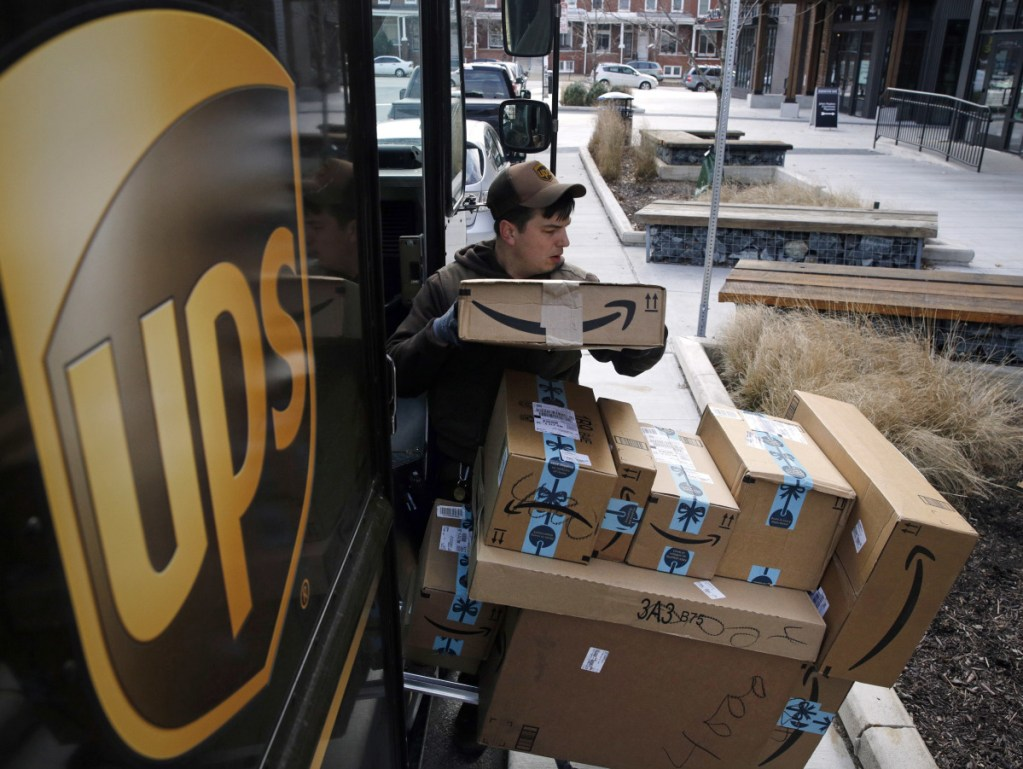 A UPS driver prepares to deliver packages Wednesday in Baltimore. The company says its busiest return day has crept up earlier in the past six years.