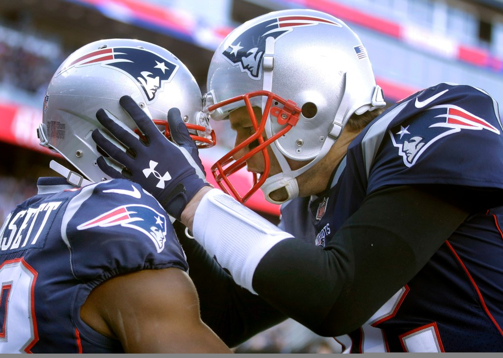 New England Patriots quarterback Tom Brady, right, celebrates his touchdown pass to wide receiver Phillip Dorsett, left, during the first half of the Patriots' 38-3 win Sunday in Foxborough, Mass.
