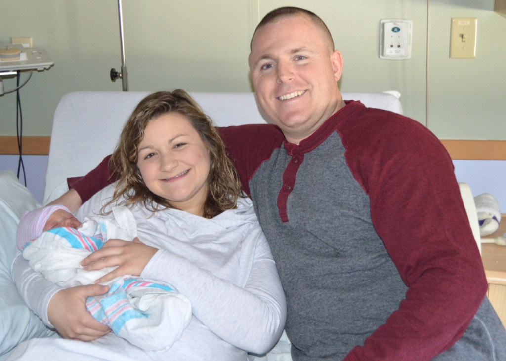 New baby Bristol rests with mom Larissa and dad Jason on Tuesday at Franklin Memorial Hospital in Farmington. The little girl was the first baby born in central Maine in 2019.