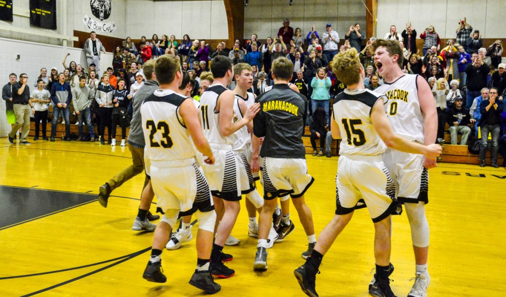 Kennebec Journal photo by Joe Phelan   Maranacook celebrates its 72-60 victory over Cony in a game Friday in Readfield.