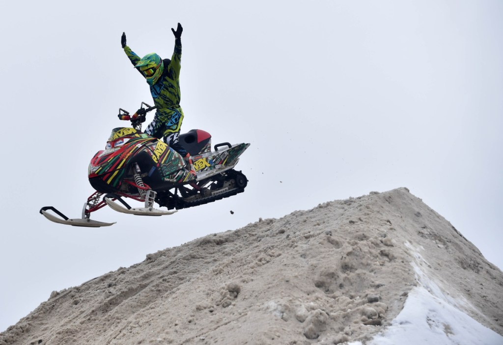A stunt rider with Ravex performs at the Snodeo in Rangeley on Friday, Jan. 21, 2017.