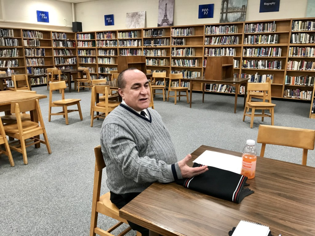 Residents of School Administrative District 49 towns listen to Superintendent Reza Namin speaking about his plans for administrative restructuring during a meeting Friday evening at Lawrence High School in Fairfield.