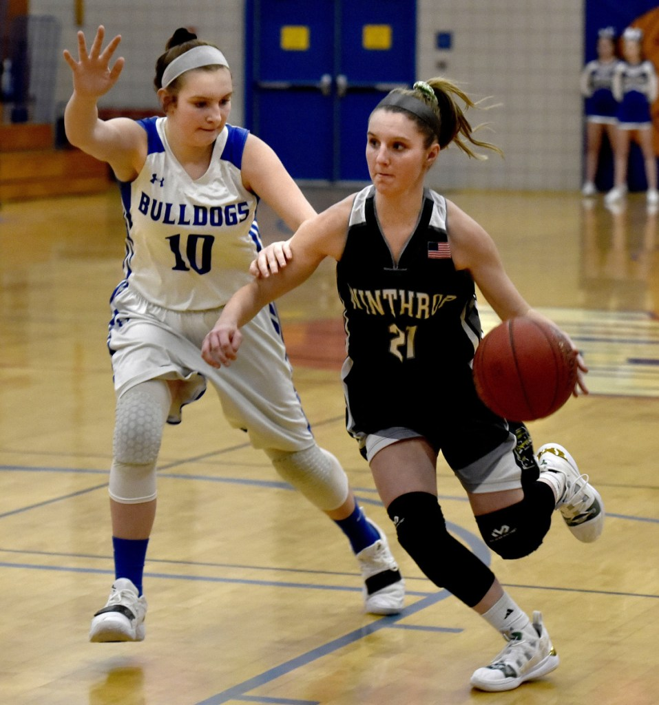 Winthrop's Katie Perkins drives against Madison's Brooke McKenney on Monday in Madison.