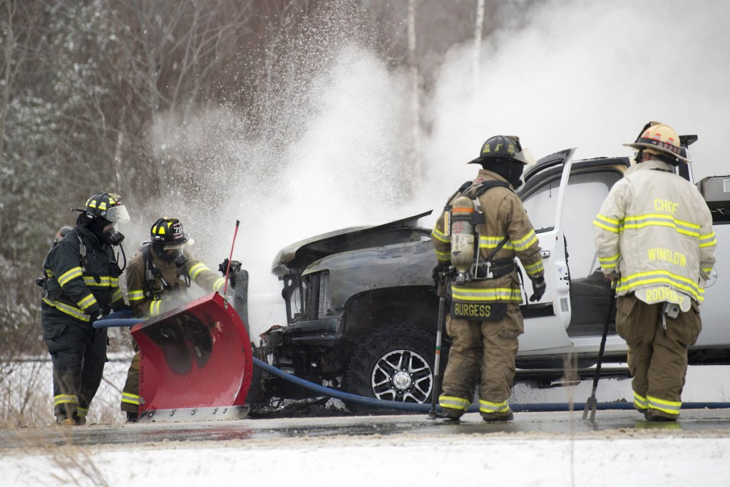 Winslow firefighters extinguish a truck fire Jan. 3 on Carter Memorial Drive in Winslow. The department finds itself short-staffed after one full-time firefighter left for another job and a second full-time firefighter will be unavailable until at least July because of an injury.