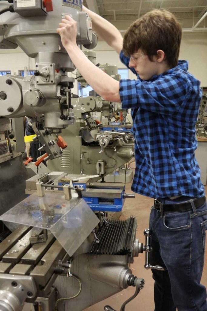 Dan Miller, a student in the precision machining program at Mid-Maine Technical Center in Waterville, and a Messalonskee High School student.
