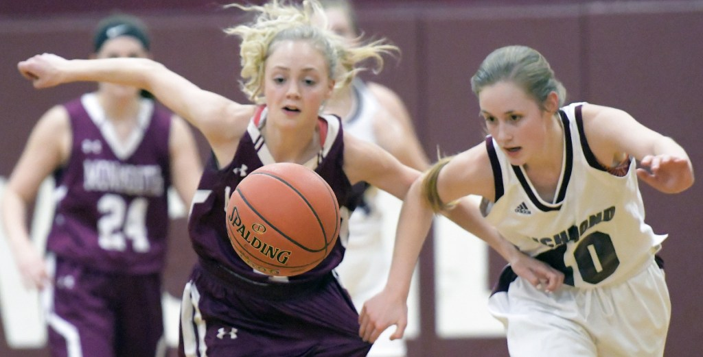 Richmond's Marybeth Sloat, right, and Monmouth's Julia Johnson chase a ball during a Mountain Valley Conference game Thursday in Richmond.