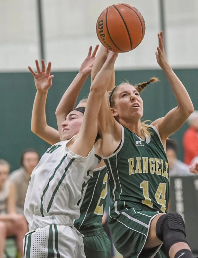 Rangeley's Emily Eastlack, right, battles for a rebound during a game Friday at Hebron Academy.