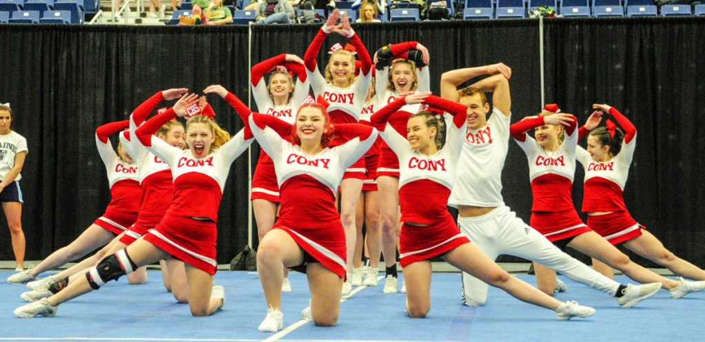 Kennebec Journal photo by Joe Phelan   The Cony Rams compete during the Class A North regional cheering competition Saturday at the Augusta Civic Center.