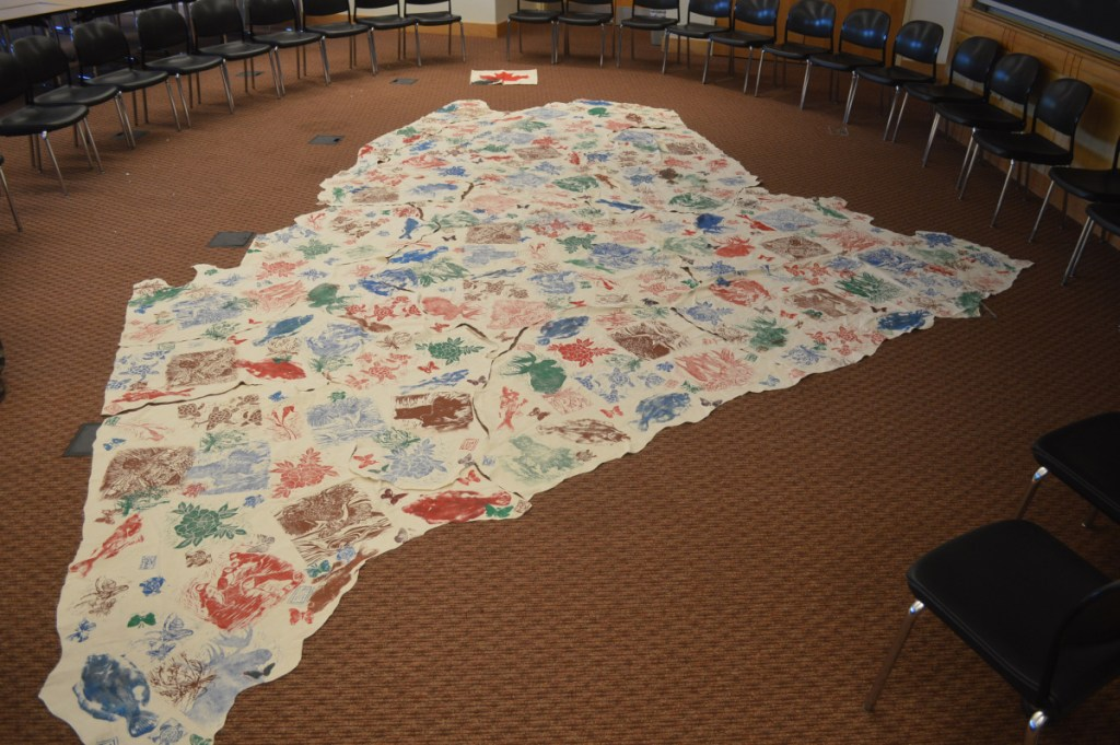A cloth map used to represent Native American land, waterways, and plants and animals in Maine before European settlers reached North America, during a Maine-Wabanaki REACH presentation Sunday at the Unitarian Universalist Community Church of Augusta.