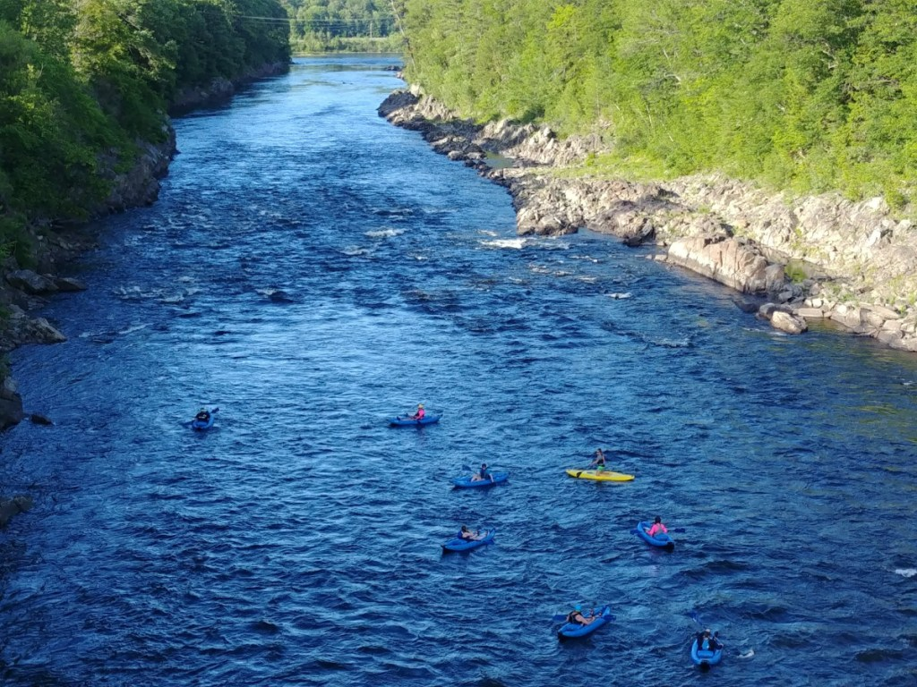 A view down the Kennebec River in Skowhegan from the walking bridge, taken in June 2018.