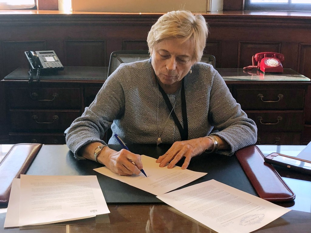 """Gov. Janet Mills signs """"Executive Order 1"""" to implement Medicaid expansion on her first day in office, making more than 70,000 Mainers eligible for health insurance."""
