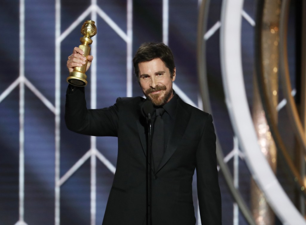 """Christian Bale accepts the Golden Globe for best actor in a motion picture musical or comedy for his role in """"Vice"""" at the Beverly Hilton Hotel on Sunday in Beverly Hills, Calif."""