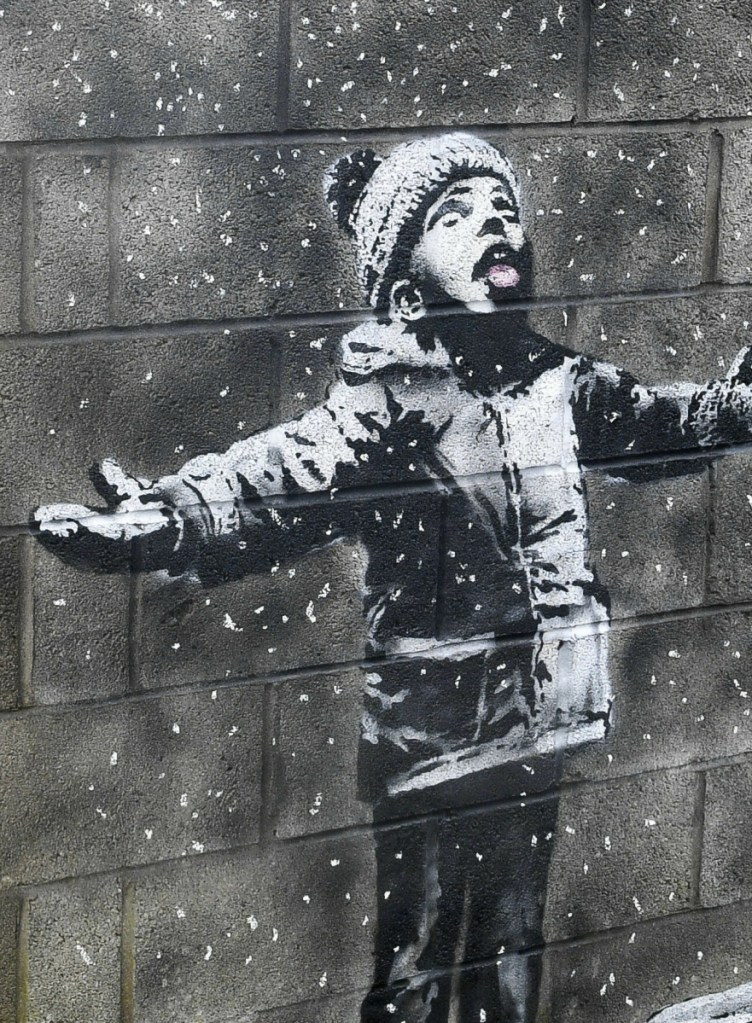 The mural, stenciled on a garage wall in Port Talbot, Wales, will remain there for at least two years.