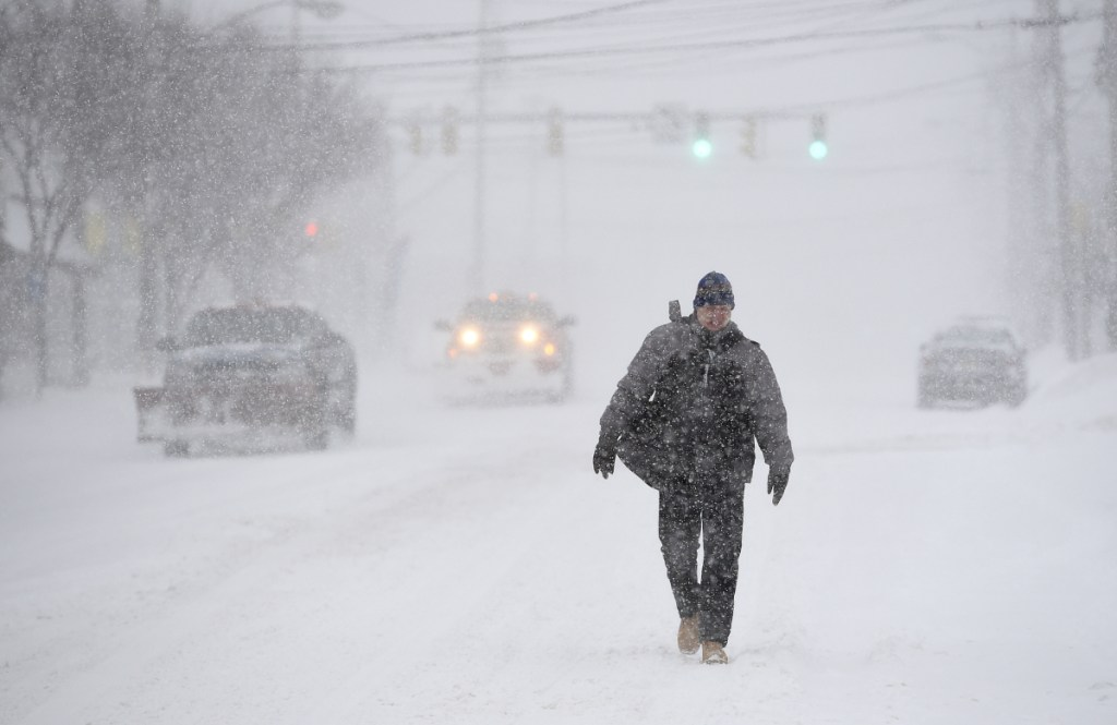 Central New York endures a snowstorm with freezing temperatures and wind in Syracuse.