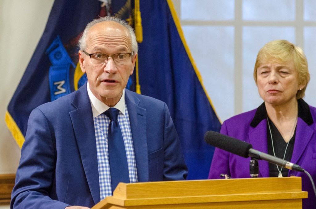 "Gordon Smith, left, is named by Gov. Janet Mills as the state's first-ever director of opioid response at a news conference on Thursday at the State House. He said, ""The opioid epidemic continues to take a horrific toll on our state."""