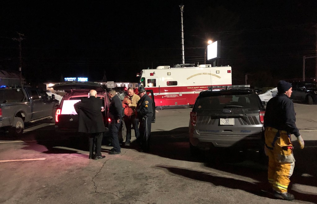 Multiple emergency vehicles and numerous personnel gather at the scene where a person is barricaded in an apartment on Route 1 in South Portland on Friday. Police evacuated the Kingswood apartment complex at 757 Main St., which is Route 1, across the street from the Best Western Merry Manor Inn.
