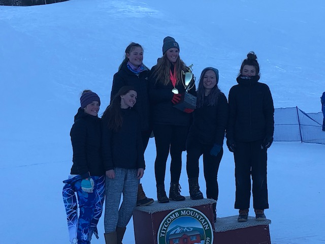 The Rangeley girls Alpine ski team celebrates its Mountain Valley Conference championship Saturday at Titcomb Mountain in Farmington. The Lakers are in their first season as a varsity program.