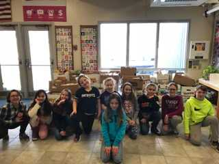 """Clinton Elementary School students recently held a """"Souper Bowl"""" food drive competition. Kierra Moody is in front. Back from left are  Paige Maxell, Jenna Furchak, Jillian Boyden, Jocelyn Clark, Kailynn Brasher,Kylie Delile, Paige Strout-Desmond, Kaylie Smith and Colton Carter."""