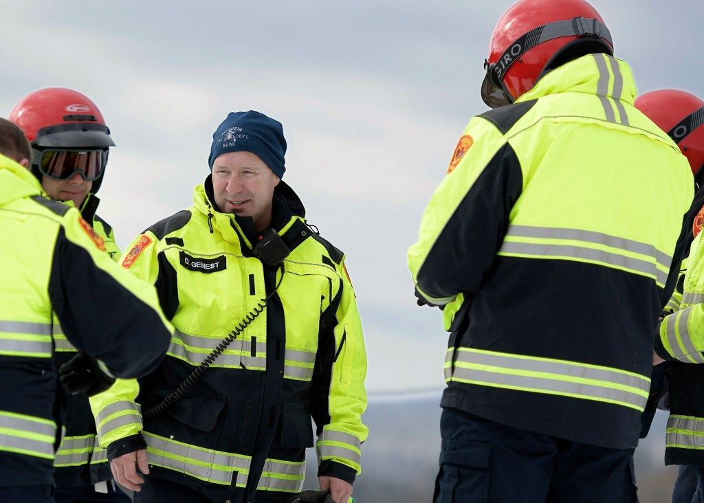 Donald Genest, center, confers with fellow firefighters during snowmobile training Feb. 21 at the Augusta Fire Department's north station in Augusta.