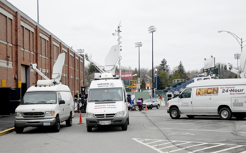Vans carrying equipment for media outlets take position at the Portland Expo today in advance of President Obama's scheduled appearance.