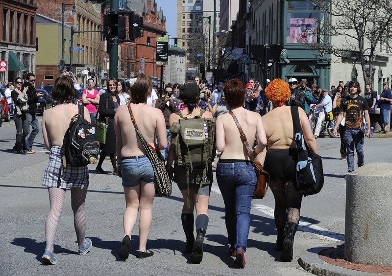 The lead five women in a group that marched topless from Longfellow Square to Tommy's Park on Saturday cross at the corner of Free and Congress streets in Portland.