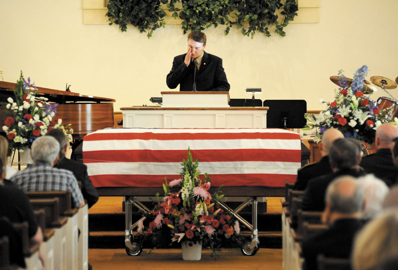 Army Spc. Wade Slack's older brother Jesse wipes a tear as he shares stories about their past Sunday at Slack's funeral at the Blessed Hope Advent Christian Church in Waterville. Slack, 21, specialized in disarming explosives and died of wounds suffered May 6 in indirect fire in Jaghatu, Afghanistan.