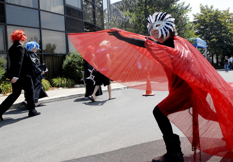A convention-goer from California dressed as the character Cat Dancer prances around outside the Wyndham hotel in South Portland during the PortConMaine convention Saturday, the peak day of the four-day convention.