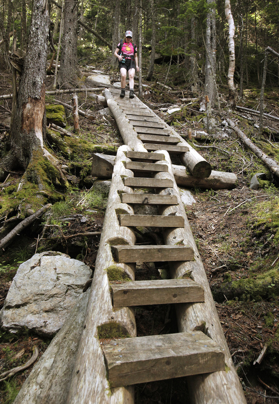 Reporter Deirdre Fleming walks down ladder steps on the part of the Grafton Loop Trail descending from Bald Mountain in Newry.