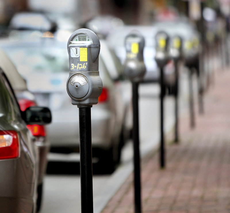 "Meters line Federal Street in Portland. Some say the city should publicize the ""Park and Shop"" program, which lets businesses give customers a free hour in public garages."