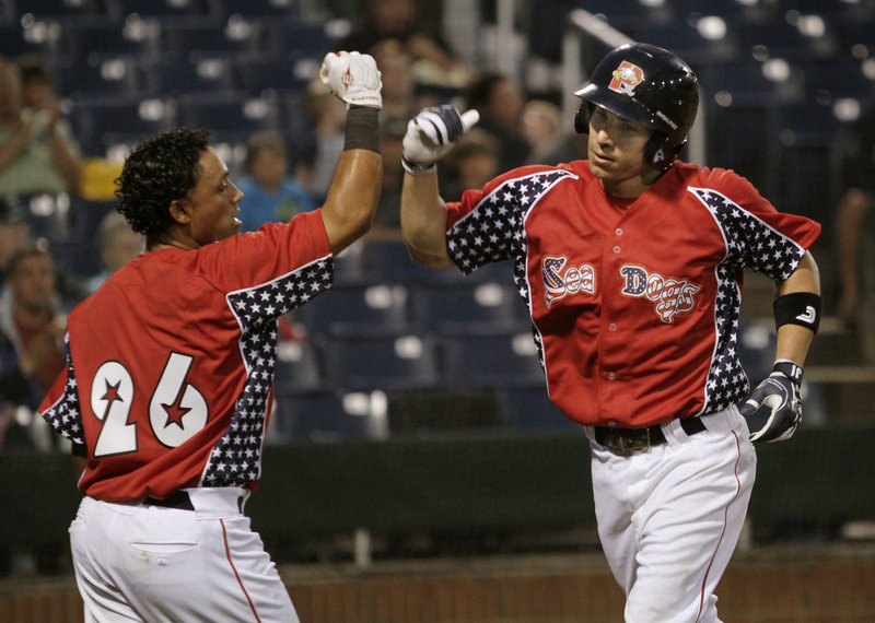 Nate Spears of the Portland Sea Dogs, right, is met at the plate by teammate Luis Segovia after hitting a two-run homer in the third inning of a 7-6 loss Saturday night to the New Britain Rock Cats. It was Spears' 10th homer of the season.
