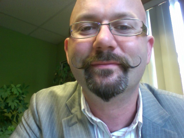 AFTER: Dr. Lou Jacobs with the handlebar moustache.