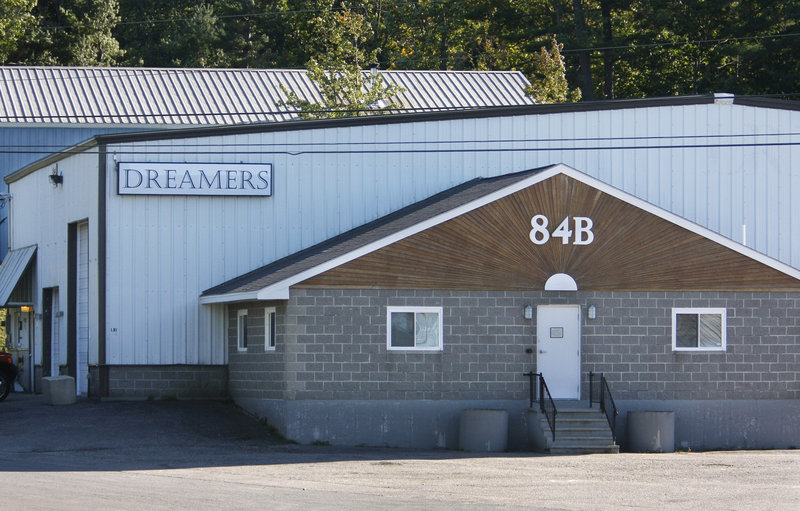 City officials say that Dreamers Cabaret's owner misrepresented the nature of his business and construction was done illegally – indoors without a permit.