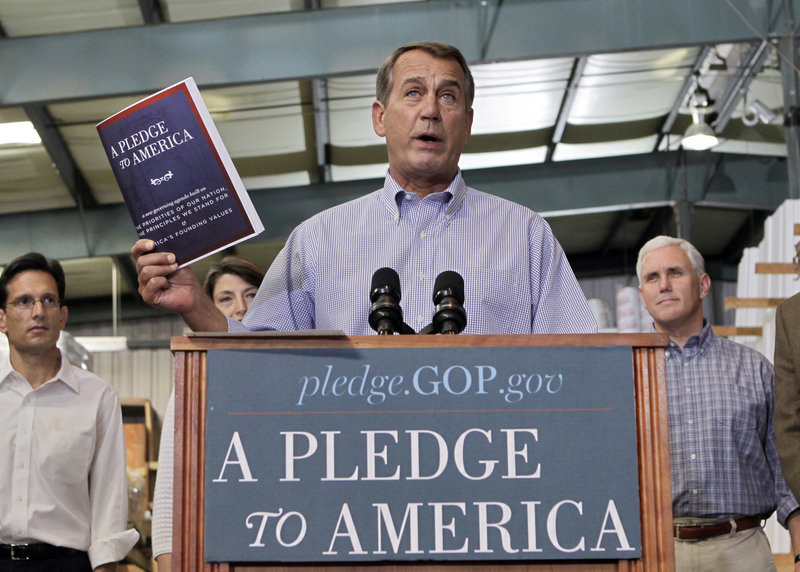 "House Minority Leader John Boehner of Ohio holds up a copy of the GOP agenda, ""A Pledge to America,"" Thursday at a lumberyard in Sterling, Va."