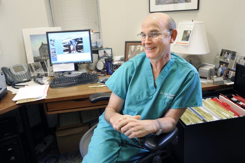 Dr. Samuel Broaddus takes a break Thursday in his South Portland office. The American College of Surgeons will recognize his international work Tuesday at a dinner in Washington, D.C.