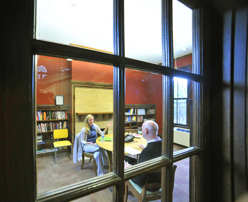 """The Reading Room, right, is often used as a meeting room. Said VIA's John Coleman: """"Every time I walked into this building ... it was so dramatic and beautiful."""""""