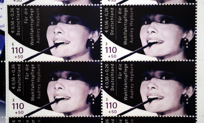 A sheet of 10 Audrey Hepburn stamps that was produced in Germany brings $606,000 in auction.
