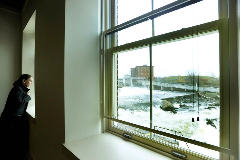 Millie Monks of Cape Elizabeth looks at a view of the Saco River from an apartment in The Mill at Saco Falls.
