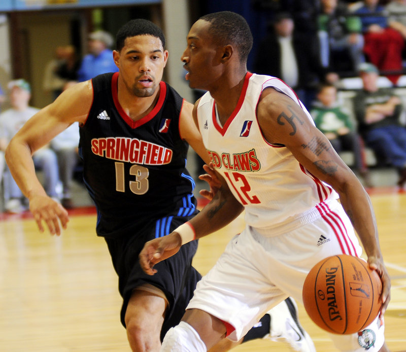 Maine's Kenney Hayes, right, dribbles past Springfield's Scottie Reynolds during the Red Claws' 102-88 win Monday night in an exhibition game. Paul Harris scored 17 points to lead the Red Claws in their only preseason game.