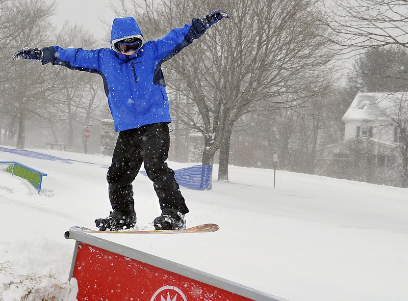 Adrian Willing hits a terrain park element at Payson Park on Monday.