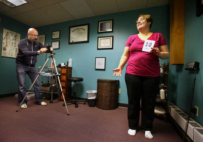 """Lou Jacobs photographs Dr. Lou's Weight Loss Challenge participant Denise Dyer of Biddeford for her """"before"""" picture Saturday in Portland. Monetary prizes will be awarded based on greatest transformation and percentage of weight lost."""