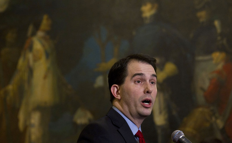 Wisconsin Gov. Scott Walker is proposing a nearly $1 billion cut in aid to schools in his two-year budget plan that would take effect in July. He argued that because of that, districts needed to get more money from their employees to help mitigate the loss in aid.