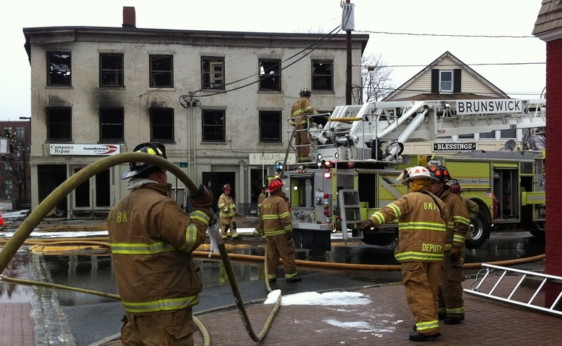 This photo shows the building at 45 Maine St. in Brunswick shortly before it was torn down after a fire Sunday.
