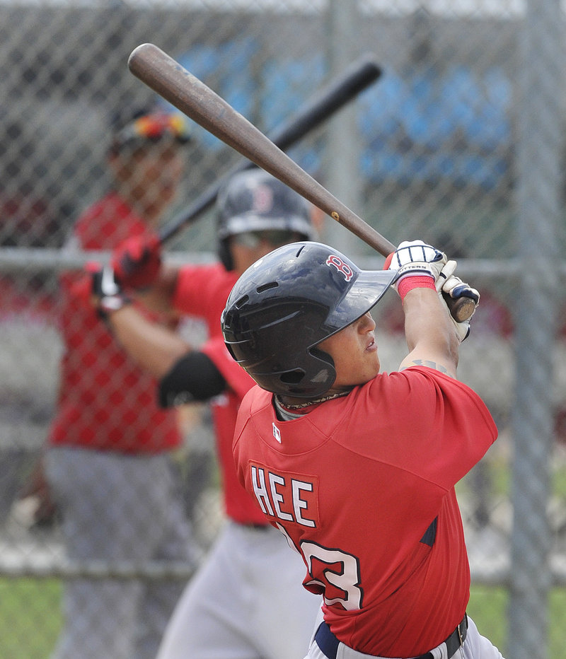 Jonathan Hee takes ground balls all around the infield when he's not taking his cuts in the batting cage. Hee will be the Sea Dogs utility player.