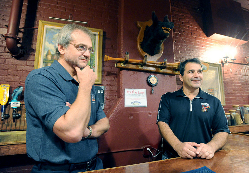 Shipyard co-owners Alan Pugsley, left, and Fred Forsley, seen in the tasting room, have created one of the top craft breweries in America.