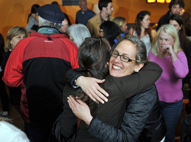 Cynthia Dill hugs a supporter as they share news of positive returns at The Buzz in Cape Elizabeth on Tuesday. Dill, a Democratic representative in the Maine House, beat the GOP's Louis Maietta Jr. to fill a vacancy in Senate District 7.