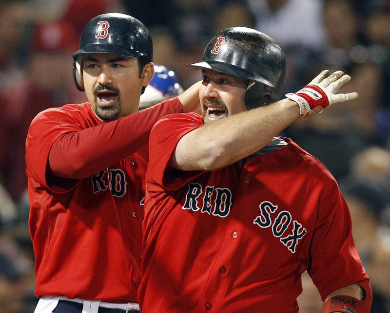 Adrian Gonzalez, left, and Kevin Youkilis celebrate Youkilis' two-run homer in the fourth inning Friday night. The Red Sox rolled up 19 hits in a 15-5 win over Chicago.