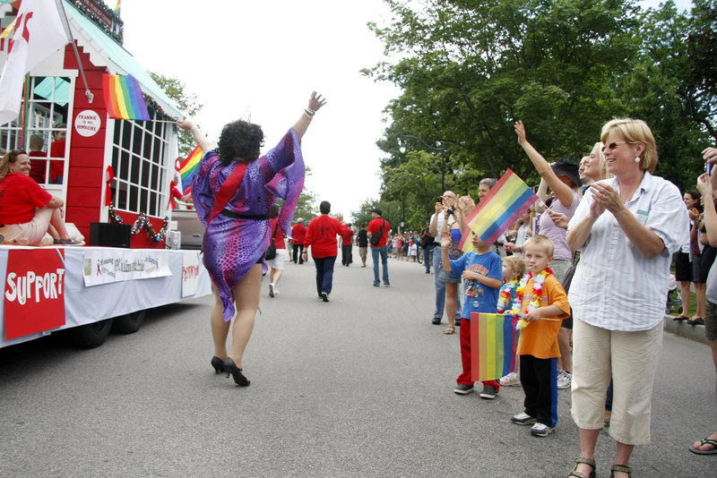 Onlookers of all ages cheer as the parade makes its way to Deering Oaks for the Saturday afternoon festival.